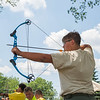 JOED VIERA/STAFF PHOTOGRAPHER- Lockport, NY-Nathan Maier draws his bow during the Iroquois Trail Council's Day Camp.