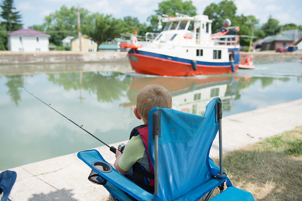 JOED VIERA/STAFF PHOTOGRAPHER-Middleport, NY- Evan Horanburg 5 watches a boat pass by while fishing in the Erie Canal Derby.
