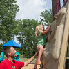 JOED VIERA/STAFF PHOTOGRAPHER- Lockport, NY-Matt Miller helps his daughter Lavinia Miller, 3,  scale a wall at the Day Road Park playground.