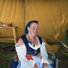 JOED VIERA/STAFF PHOTOGRAPHER- Olcott, NY-Quenching wench Esmeralda (Pamela Chihil) sits in her tent at the Pirates Festival.