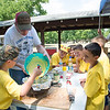 JOED VIERA/STAFF PHOTOGRAPHER- Lockport, NY-Boy scouts learn how to make a cobbler during the Iroquois Trail Council's Day Camp.