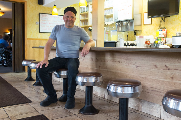 JOED VIERA/STAFF PHOTOGRAPHER- Middleport, NY-Darrell Gilbert sits at the counter in Darrell's Place.