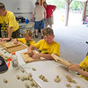 JOED VIERA/STAFF PHOTOGRAPHER- Lockport, NY-Boy scouts make cork boards using wine corks during the Iroquois Trail Council's Day Camp.
