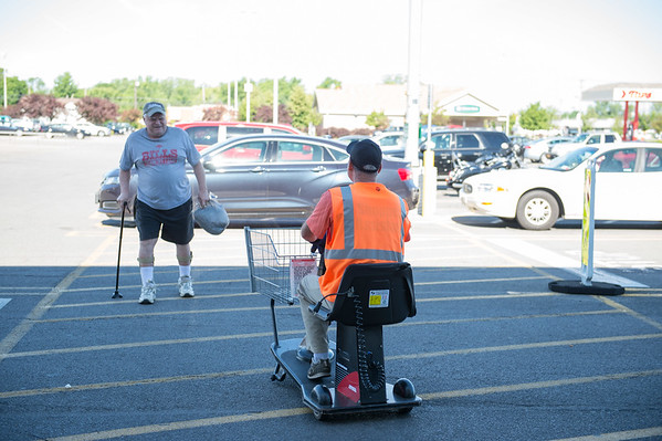 JOED VIERA/STAFF PHOTOGRAPHER-Lockport, NY-  Dan Becken brings out a motorized cart for customer at Tops on Transit Road.