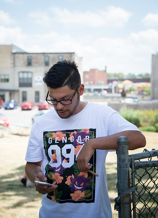 JOED VIERA/STAFF PHOTOGRAPHER- Lockport, NY-Aaron Harris stops by the Erie Canal Discovery Center to catch a pokemon.