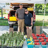 JOED VIERA/STAFF PHOTOGRAPHER-Newfane, NY- Justin Westmorland and Ashley Duxbury wait for customers at Ashley Farms booth during the Newfane Farmers Market.