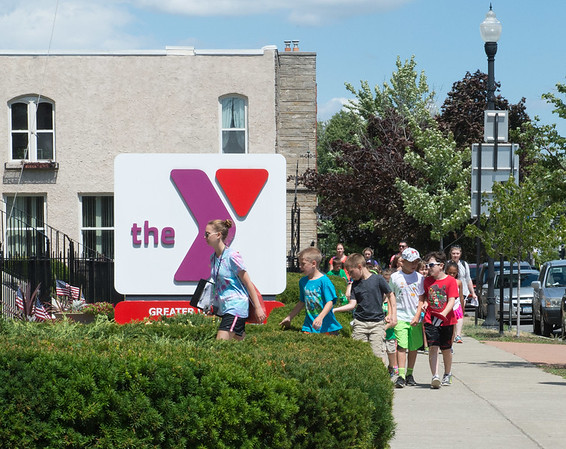 JOED VIERA/STAFF PHOTOGRAPHER- Lockport, NY-Kids come back to the YMCA after a walk.
