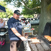 JOED VIERA/STAFF PHOTOGRAPHER-Newfane, NY- Brian Scott grills hotdogs and sausages during the Newfane Farmers Market.