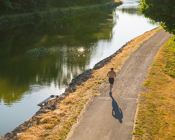 JOED VIERA/STAFF PHOTOGRAPHER-Middleport, NY-A man runs alongside the canal as seen from the Carmen Road Bridge.