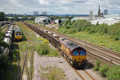 DB Cargo's 66158 trundles slowly along the Arrival/Departure road with 6Exx 1145 New Biggin Britih Gypsum - Milford West Sidings as Freightliner's 66616 waits to depart Hunslet Yard with four empty wagons running as an additional 6xxx 1520 to York Yard South (05/07/2016)
