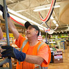 JOED VIERA/STAFF PHOTOGRAPHER-Lockport, NY-  Dan Becken helps put a Olympics sign up at Tops on Transit Road.