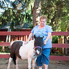 JOED VIERA/STAFF PHOTOGRAPHER- Burt, NY-Sandy Klinger pets one of the ponies at Equistar.