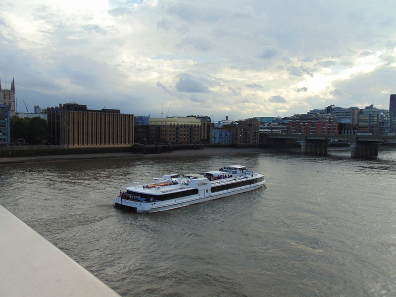 The Silver Sturgeon catamaran heading under London Bridge along the Thames.