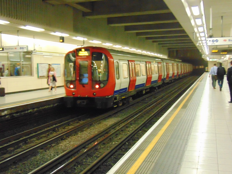 A train of London Underground S-stock leaving Blackfriars on a Circle Line service.