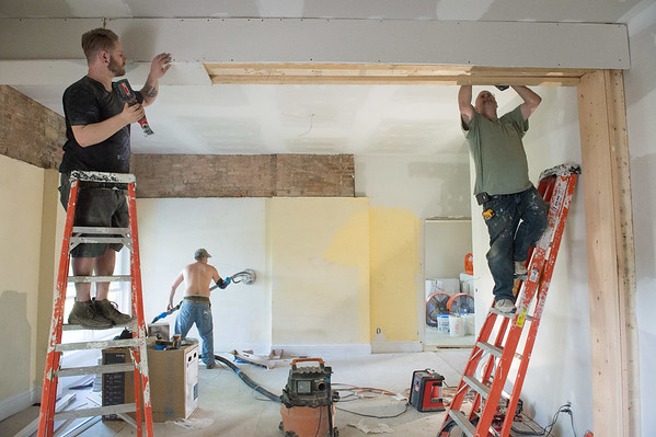 JOED VIERA/STAFF PHOTOGRAPHER-Lockport, NY-A crew works on the Tooth House on Willow Street.