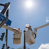 JOED VIERA/STAFF PHOTOGRAPHER-Lockport, NY-Crews replace a fixture on a street lamp on Main Street.