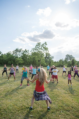 JOED VIERA/STAFF PHOTOGRAPHER-Lockport, NY-  Amanda Vincek leads a zumba class at Day Road Park.
