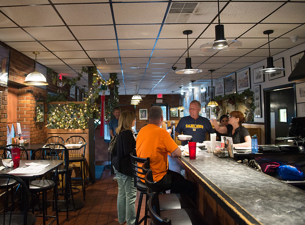 JOED VIERA/STAFF PHOTOGRAPHER-Lockport, NY- Patrons sit at the bar at Molinaro's Restaurant.