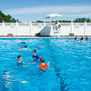 JOED VIERA/STAFF PHOTOGRAPHER-Lockport, NY-  Students take a dip in the Lockport Town and Country Club pool during Desales' Field Day.