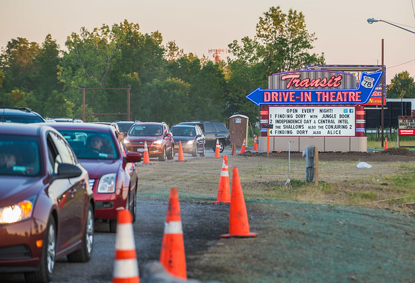 JOED VIERA/STAFF PHOTOGRAPHER-Lockport, NY-Cars line up in the new lane at the Transit Drivein Theatre.