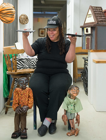 JOED VIERA/STAFF PHOTOGRAPHER-Lockport, NY- Maeda Taylor shows off puppets at her studio at ART247.
