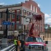 JOED VIERA/STAFF PHOTOGRAPHER-Lockport, NY-Crews replace a fixture on a street lamp on Main Street.