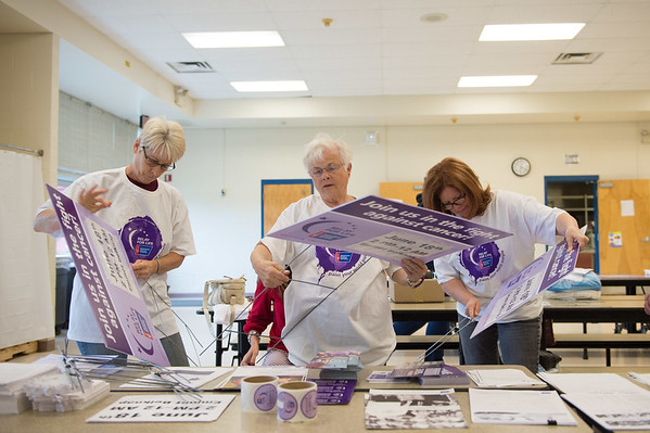 JOED VIERA/STAFF PHOTOGRAPHER-Lockport, NY-Relay For Life members are busy getting the word out about Saturday's big event in Lockport. Assembling signs for the community are Wendy Milliman, Nancy Middaugh and Meg Wager.