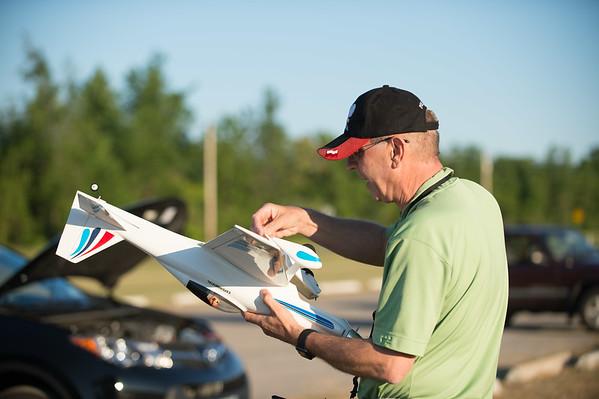 JOED VIERA/STAFF PHOTOGRAPHER-Lockport, NY-Rob Panek adjusts his RC model airplane at Niagara County Radio Control Flying Field.