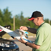 JOED VIERA/STAFF PHOTOGRAPHER-Lockport, NY-Rob Panek adjusts his RC model airplane at Niagara County Radio Control Flying Field.