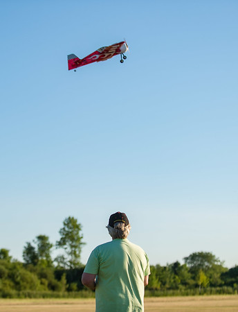 JOED VIERA/STAFF PHOTOGRAPHER-Lockport, NY-Walt Blace flys a RC model airplane at Niagara County Radio Control Flying Field.