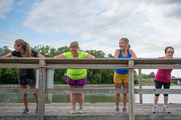JOED VIERA/STAFF PHOTOGRAPHER-Lockport, NY-  Olivia Vorhoozer, Lydia Scott, Adrienne Bender and Sophia Laubackerdo push ups during a boot camp at Nelson C. Goehle Marina.