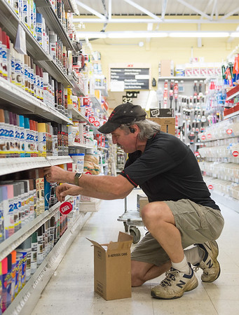 JOED VIERA/STAFF PHOTOGRAPHER-Lockport, NY- Bob Voisin stocks shelves at the Spalding Ace Hardware store.