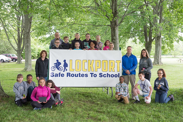 JOED VIERA/STAFF PHOTOGRAPHER-Lockport, NY-Students surround a safe routes to school banner at Joe Kibbler Park.