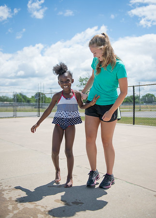 JOED VIERA/STAFF PHOTOGRAPHER-Lockport, NY-Park Leader Erin Geier and Jada Davidson 7 play around at the Lockport Community Pool during open swim.