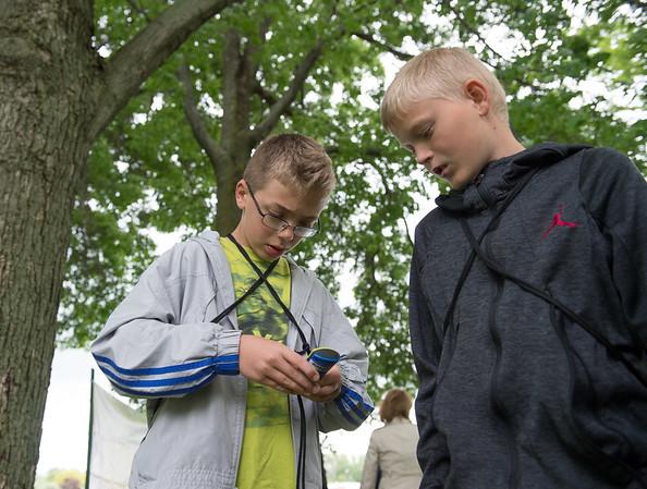 JOED VIERA/STAFF PHOTOGRAPHER-Lockport, NY-Clay Foster 11 and Aidan Everett 11 operate a geocaching device at Joe Kibbler Park.