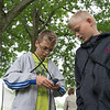 JOED VIERA/STAFF PHOTOGRAPHER-Lockport, NY-Clay Foster 11 and Aidan Everett 11 operate a geocaching device at Joe Kibbler Park.