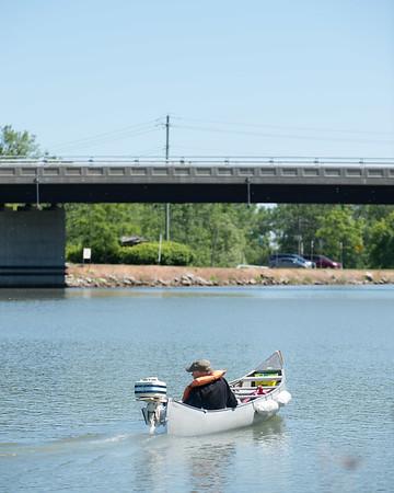 JOED VIERA/STAFF PHOTOGRAPHER-Lockport, NY-A man rides his canoe on the canal.