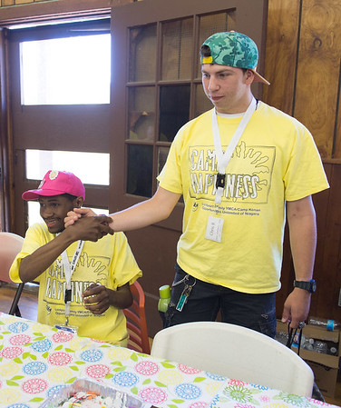 JOED VIERA/STAFF PHOTOGRAPHER-Barker, NY-  Longtime camp buddies Sam Thames and Chris Bunnell greet each other before arts and crafts during Camp Happiness at Camp Kenan.