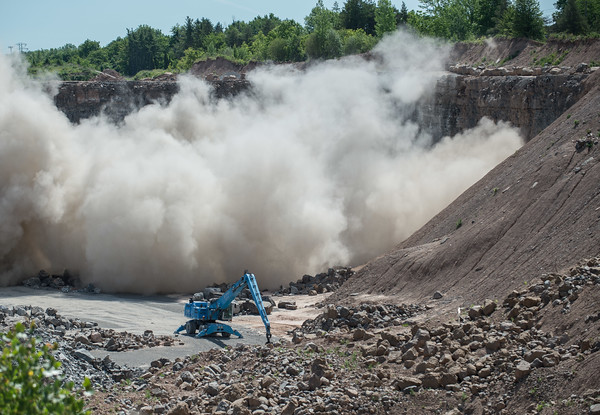 JOED VIERA/STAFF PHOTOGRAPHER-Lockport, NY- A controlled explosion excavates limestone from Lafarge's Lockport Quarry.