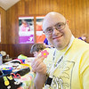 JOED VIERA/STAFF PHOTOGRAPHER-Barker, NY-  Daniel Cecere holds up a flower sticker while making a hat during Camp Happiness at Camp Kenan.