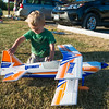 JOED VIERA/STAFF PHOTOGRAPHER-Lockport, NY-Hudson Farrell, 2, plays with a RC model airplane at Niagara County Radio Control Flying Field.