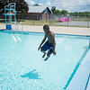 JOED VIERA/STAFF PHOTOGRAPHER-Lockport, NY-Jahkwon Davis 9 is the first kid to jump in the Lockport Community Pool during open swim.