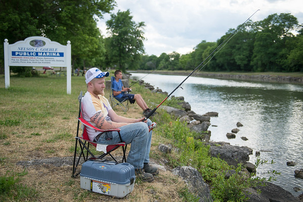 JOED VIERA/STAFF PHOTOGRAPHER-Lockport, NY-  Elias Parker and Conner Jordan fish together along the canal at Nelson C. Goehle Marina.