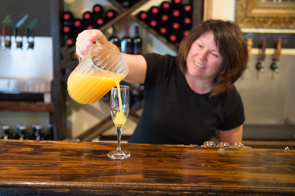 JOED VIERA/STAFF PHOTOGRAPHER-Gasport, NY-  Julie Miller pours a mimosa at Becker Brewery.