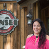 JOED VIERA/STAFF PHOTOGRAPHER-Lockport, NY-Shelly Elia stands by the new sign at Sunset Grill.