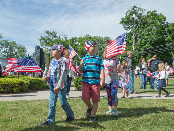 JOED VIERA/STAFF PHOTOGRAPHER-Wilson, NY-Wilson Elementary School students march through the Village during their 2nd Annual Flag Day Parade. The parade ended with an assembly in front of Wilson High School where students and observers listened to songs played by the Elementary School's band.