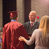 JOED VIERA/STAFF PHOTOGRAPHER-Pendleton, NY-Board of Education president Michael Zimmerman presents Jacob Salada, 19, with his diploma as special education teacher Kathy Kreppenneck helps Salada walk across the Starpoint stage.