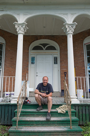 JOED VIERA/STAFF PHOTOGRAPHER-Lockport, NY-Owner Randy Zglinicki poses for a photo outside of the Tooth House on Willow Street.