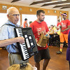 JOED VIERA/STAFF PHOTOGRAPHER-Barker, NY-  Clancy Burkwit from the Newfane Lions Club plays the accordian as campers eat lunch during Camp Happiness at Camp Kenan.