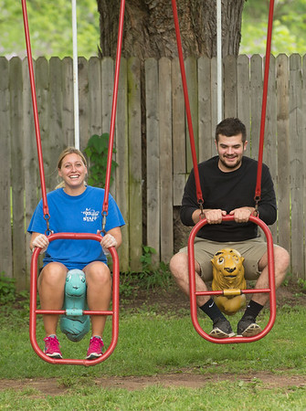 JOED VIERA/STAFF PHOTOGRAPHER-Lockport, NY- Jessica O'Connor and Anthony Provenzano enjoy themselves on swings at the newly reopened park behind Widewaters.